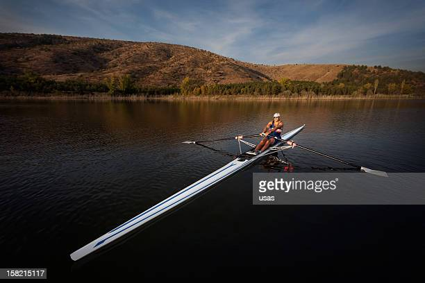 Rower man on boat shot with wide angle