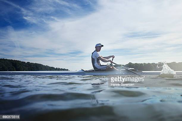 A rower on a lake