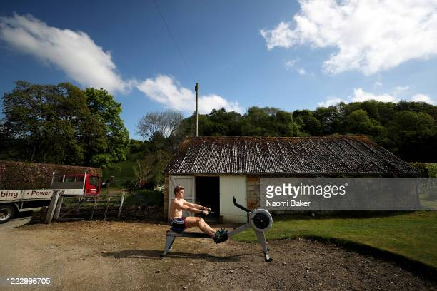 Rower Tom George of the Great Britain rowing team trains in isolation at his home on May 05 2020 in Cheltenham England The coronavirus and the...