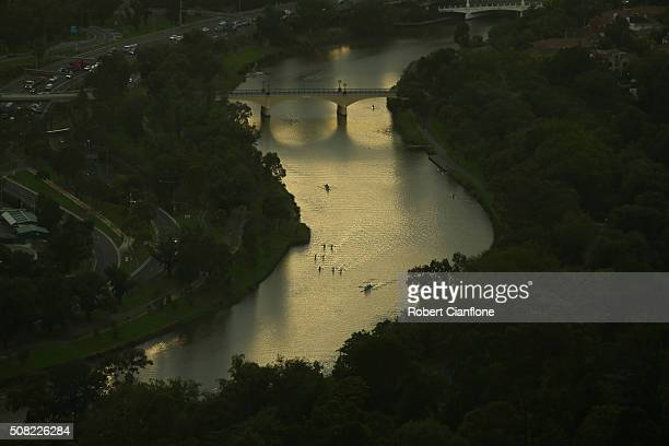 Rowers are seen on the Yarra River at sunrise from the Eureka Skydeck on February 4 2016 in Melbourne Australia