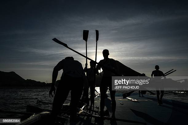 Rowers arrive for a training session before the race at the Lagoa Rodrigo de Freitas in Rio de Janeiro during the Rio 2016 Olympic Games on August 7...