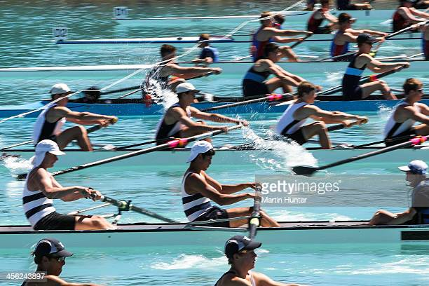 Rowers compete in the Boys Coxed Four during the 2013 Meridian Otago Championships at Lake Ruataniwha on December 14, 2013 in Otago Harbour, New...