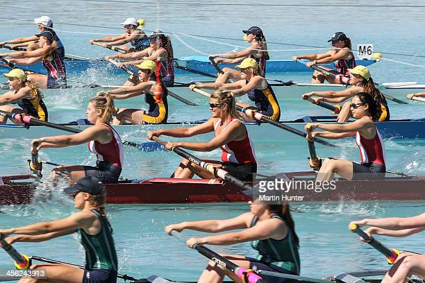 Rowers compete in the Womens Coxed Eight during the 2013 Meridian Otago Championships at Lake Ruataniwha on December 14, 2013 in Otago Harbour, New...