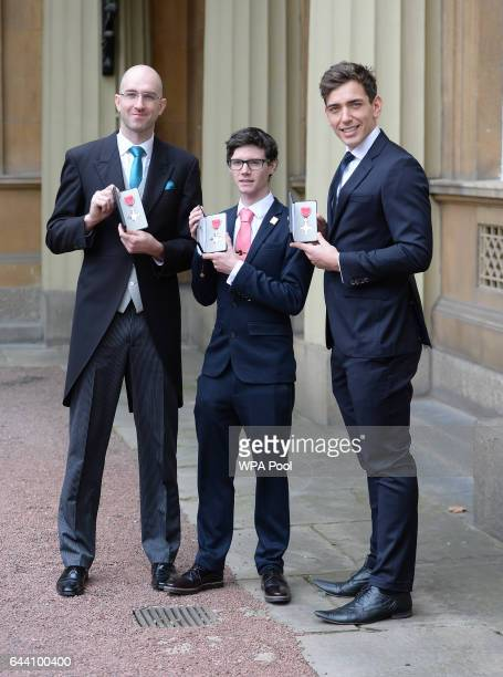 Rowers Dan Brown Oliver James and James Fox after they received their Member of the Order of British Empire medals from Queen Elizabeth II at...