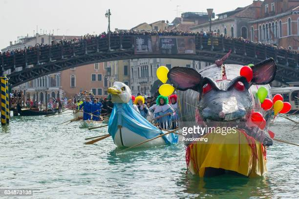 Rowers dressed with costumes sail under the Accademia Bridge at the traditional regatta on the Grand Canal on the opening day of the Venice Carnival...