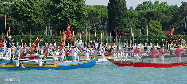 Rowers from several associations lift their oars to salute the Navy cadets during the Sensa procession in Bacino St Mark on June 5 2011 in Venice...
