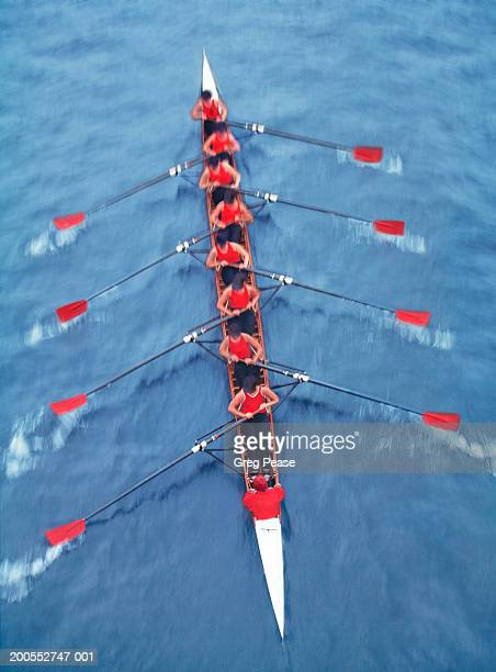 rowers in eight person-scull, elevated view (blurred motion) - crew photos et images de collection