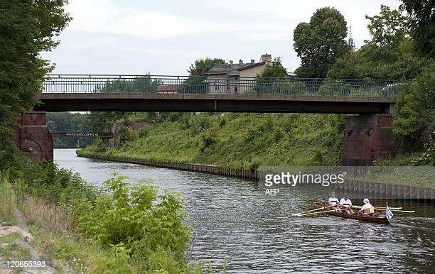 Rowers make their way through the Teltow canal on July 20, 2011 in Klein Glienicke, district of Potsdam, eastern Germany. During the times of the...