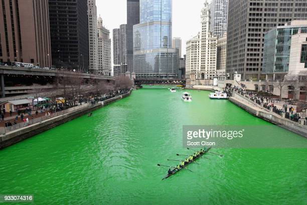 Rowers navigate the Chicago River shortly after it was dyed green in celebration of St Patrick's Day on March 17 2018 in Chicago Illinois Dyeing the...