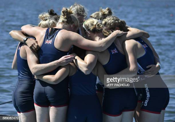 Rowers of Britain's team celebrate after being second the Women's Eight final rowing competition at the Lagoa stadium during the Rio 2016 Olympic...