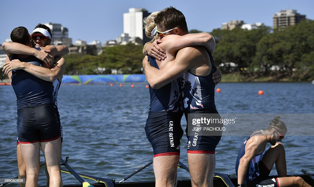 Rowers of Britain's team celebrate after winning the Men's Eight final rowing competition at the Lagoa stadium during the Rio 2016 Olympic Games in Rio de Janeiro on August 13, 2016. / AFP / Jeff PACHOUD