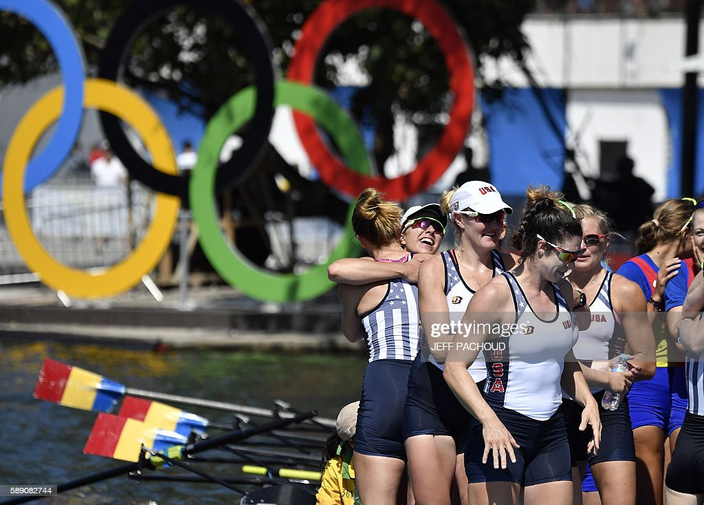 Rowers of the USA's team celebrate after winning the Women's Eight final rowing competition at the Lagoa stadium during the Rio 2016 Olympic Games in Rio de Janeiro on August 13, 2016. / AFP / Jeff PACHOUD