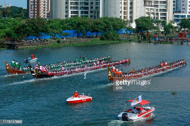 Rowers on traditional wooden boats from Kerala known as snake boats participate in the Champions Boat League held at the backwaters of Kochi in...