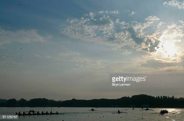 Rowers practice at sunrise prior to the FISA Senior and Junior World Rowing Championships on July 29, 2004 in Banyoles, Spain.