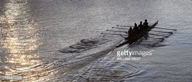 Rowers steer their craft up Melbourne's Yarra River in the early morning light on July 5, 2019