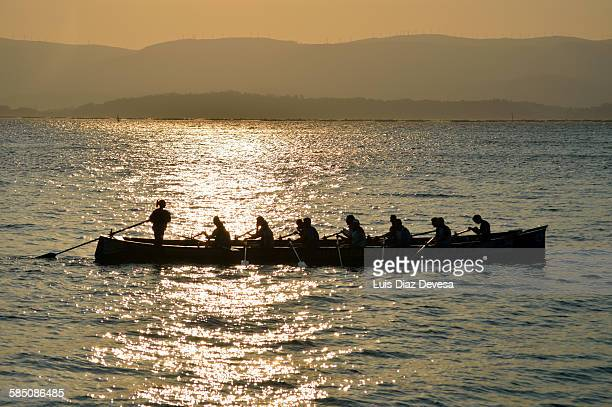 Rowers training at sunset