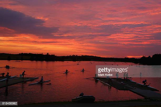 Rowers warmup as they prepare for racing as the sun rises on the first day of competition during the 2016 Sydney International Rowing Regatta on...