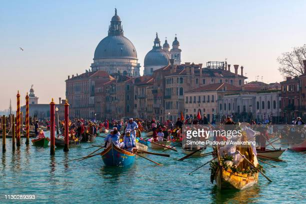 Rowers wearing carnival costumes attend the traditional Carnival Regatta along the Grand Canal on February 17 2019 in Venice Italy The theme for the...