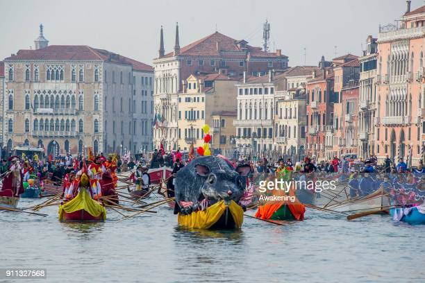 Rowers wearing costumes sail along Grand Canal for the opening of the 2018 Venice Carnival on January 28 2018 in Venice Italy The theme for the 2018...