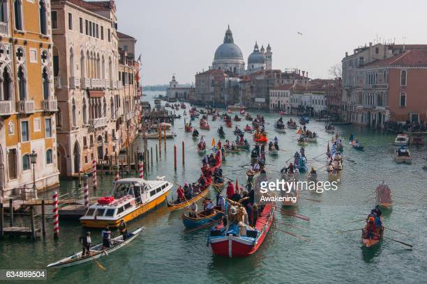 Rowers wearing costumes sail along the Grand Canal for the Carnival Regatta on the opening day of the Venice Carnival on February 12 2017 in Venice...