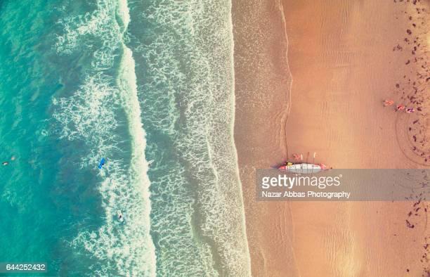 Rowing Boat at Orewa Beach.