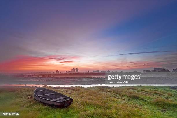 Rowing boat at sunrise