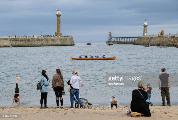 A rowing boat heads out of the harbour during the annual Whitby Regatta on August 10 2019 in Whitby England At over 170 years old the Whitby Regatta...