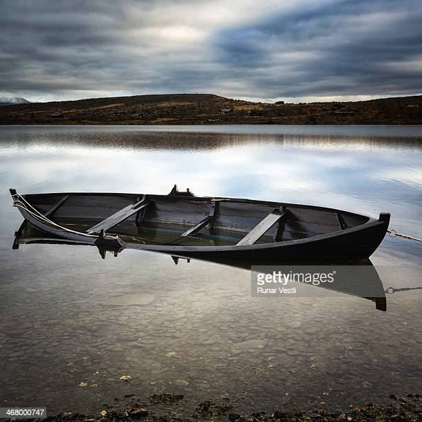 Rowing boat in a mountain lake at dusk