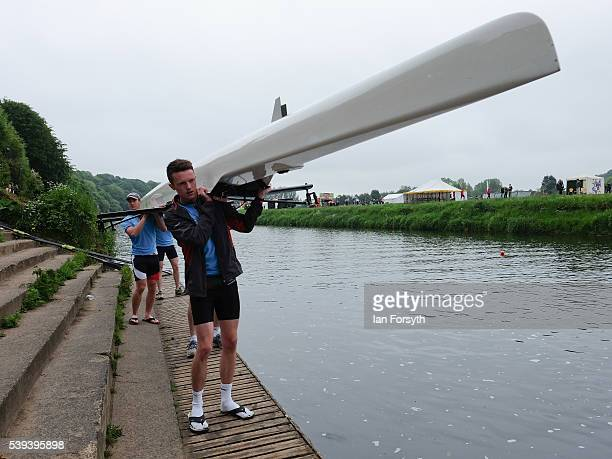A rowing crew prepare to lower their boat into the water as they compete in the 183rd annual regatta on the River Wear on June 11 2016 in Durham...