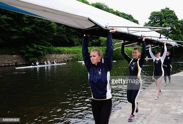 A rowing crew prepares to lower their boat into the water as they take part in the 183rd annual regatta on the River Wear on June 11 2016 in Durham...