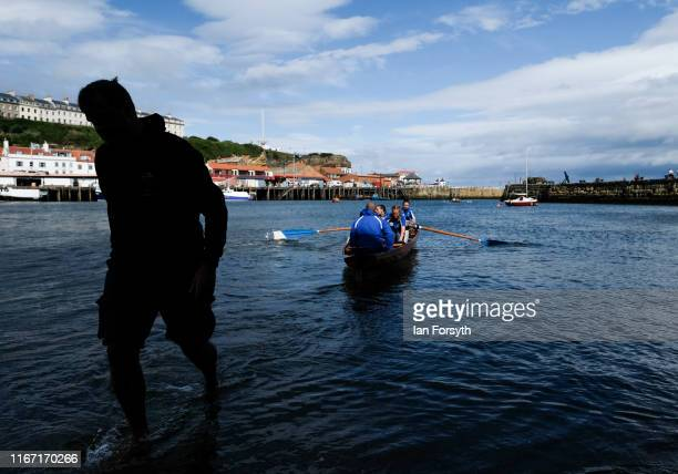 A rowing crew takes to the water as they head to the start point for their race during the annual Whitby Regatta on August 10 2019 in Whitby England...