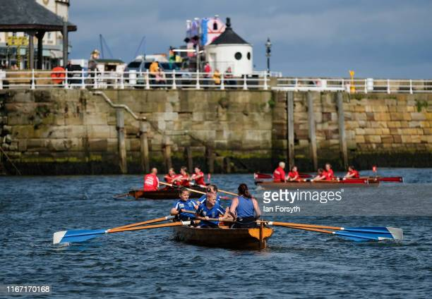 Rowing crews take to the water as they head to the start point for their race during the annual Whitby Regatta on August 10 2019 in Whitby England At...
