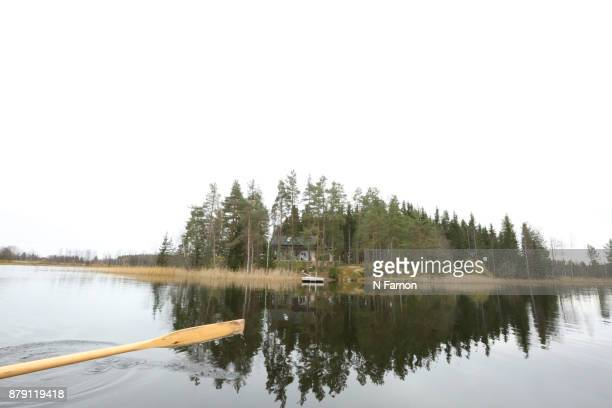 Rowing past an island in Finland