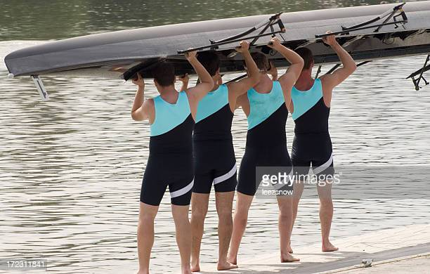 rowing series - putting boat in - carrying stock photos and pictures