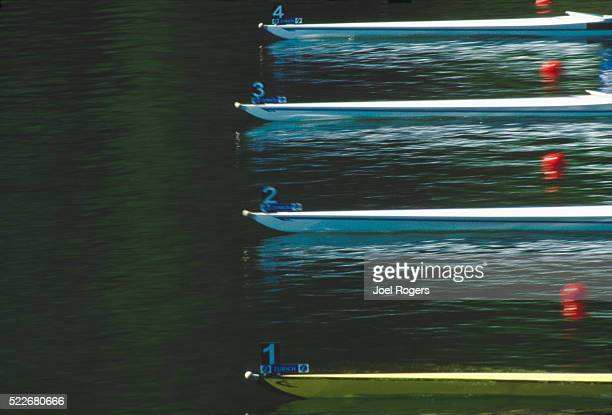 Rowing shell bows at race start, blur motion