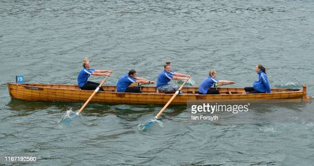 A rowing team approach the finish line during their competition at the annual Whitby Regatta on August 10 2019 in Whitby England At over 170 years...