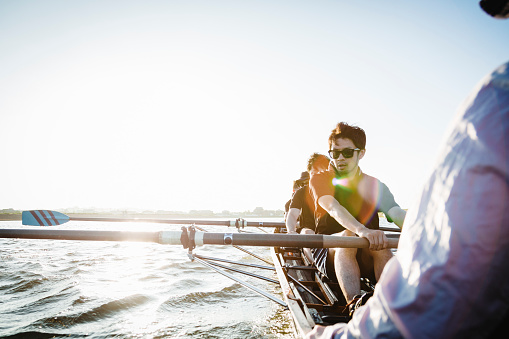 Rowing team in scull on the river - gettyimageskorea