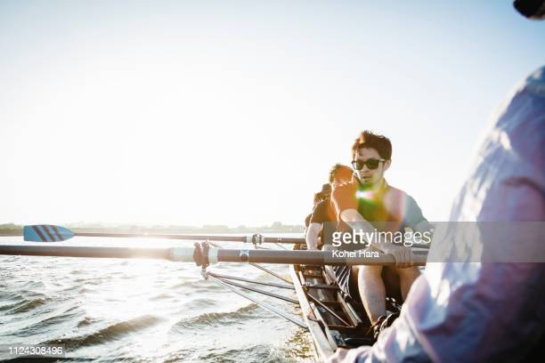 rowing team in scull on the river - aquatic sport stock pictures, royalty-free photos & images