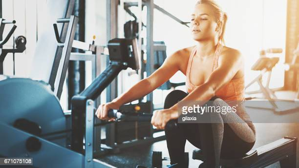rowing workout at gym. - endurance stock photos and pictures
