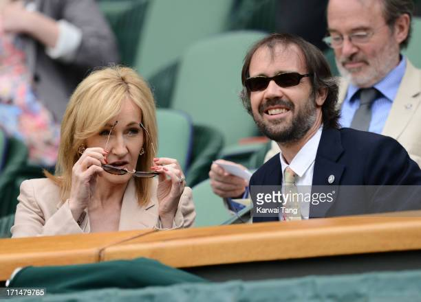 J K Rowling and husband Neil Murray attend Day 2 of the Wimbledon Tennis Championships 2013 at Wimbledon on June 25 2013 in London England