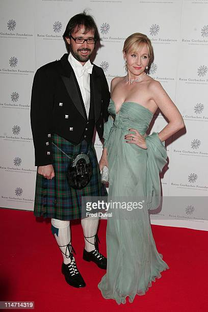 JK Rowling and husband Neil Murray during Raisa Gorbachev Foundation Party Red Carpet at Hampton Court Palace in London United Kingdom