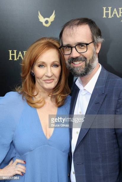 K Rowling and husband Neil Murray pose at Harry Potter and The Cursed Child parts 1 2 on Broadway Opening Night at The Lyric Theatre on April 22 2018...
