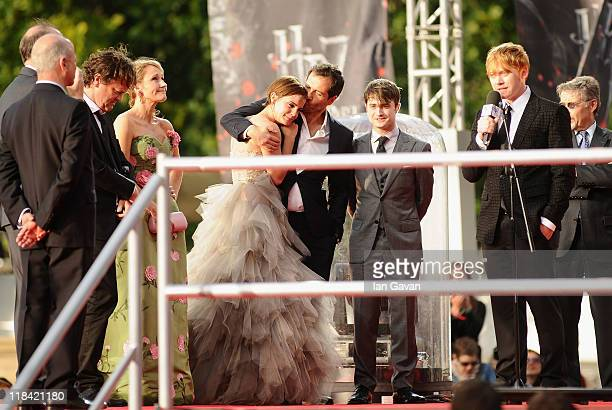 Rowling Emma Watson Jason Isaacs and Daniel Radcliffe look on as Rupert Grint speak to the fans on stage during the World Premiere of Harry Potter...