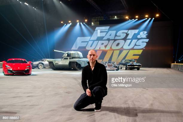 Rowly French the creative director of the show poses infront of cars from the show during the 'Fast Furious Live' technical rehearsal at NEC Arena on...