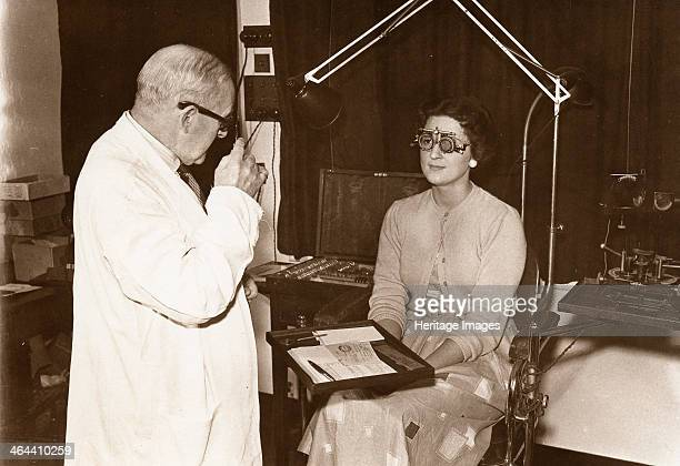 Rowntree optician at work York Yorkshire 1956 A female member of staff is having her eyes examined