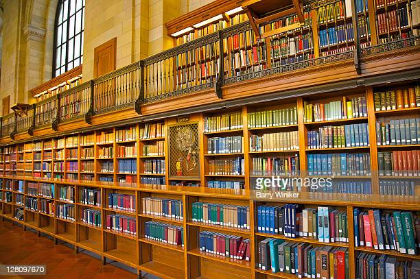 rows and rows of books in north hall, new york public library, new york - new york public library stock pictures, royalty-free photos & images
