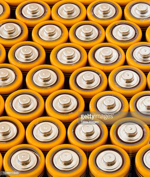 rows of aa batteries - battery stock photos and pictures