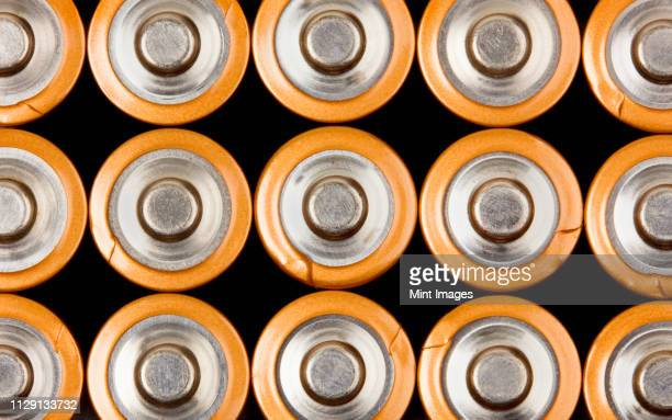 rows of aa batteries - alcoholics anonymous stock pictures, royalty-free photos & images