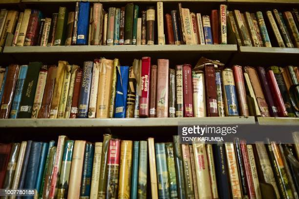 Rows of ageing volumes sit on a book rack inside the colonialera McMillan Memorial Library in the Kenyan capital Nairobi established in 1931 and...