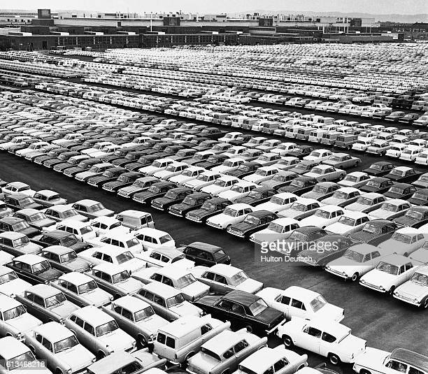Rows of automobiles in the yard of a Ford Motor Company plant